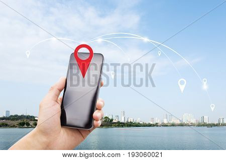 mobile phone with modern buildings near water in nanjing