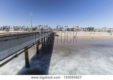 Los Angeles, California, USA - June 26, 2017:  Venice beach pier with motion blur waves.