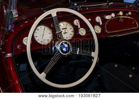 MAASTRICHT NETHERLANDS - JANUARY 15 2016: Cabin of a vintage car BMW 328 Roadster 1936. International Exhibition InterClassics & Topmobiel 2016