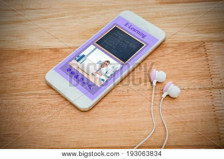 Digitally generated image of e-learning interface against white smartphone with white headphones