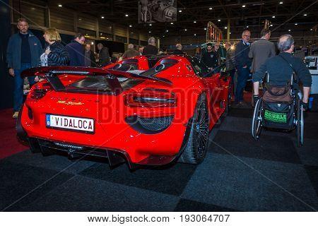 MAASTRICHT NETHERLANDS - JANUARY 15 2016: Hypercar Porsche 918 Spyder. Rear view. International Exhibition InterClassics & Topmobiel 2016