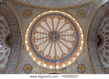 Istanbul, Turkey - April 16, 2017: Decorated ceiling at Sultan Ahmed Mosque (Blue Mosque) showing the main big dome Istanbul Turkey