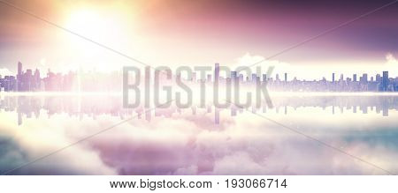 Copyspace of a city landscape  against tranquil scene of bright sun over cloudscape