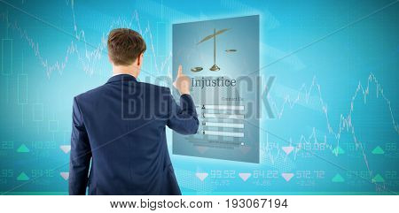 Businessman pointing something with his finger against stocks and shares