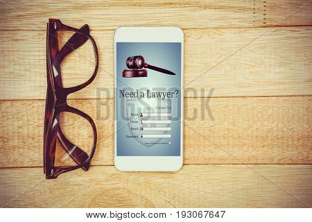 Graphic interface of lawyer contact form  against view of glasses and a smartphone