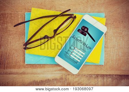 Graphic interface of lawyer contact form  against close up view of smartphone and glasses