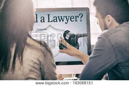 Graphic interface of lawyer contact form  against graphic designers working at desk in the office