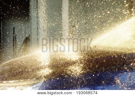 Worker Cleaning Car With Pressured Water, Car Wash