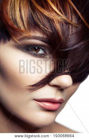 Fashion portrait of a beautiful girl with colored dyed hair, professional short hair coloring. isolated on white background. studio shot.