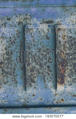 Blue rusted door texture. Blue old metal closeup. Rusty metal background & texture. Abstract texture & background for designers. Grunge old rusty scratched surface texture. Abstract rusted surface.