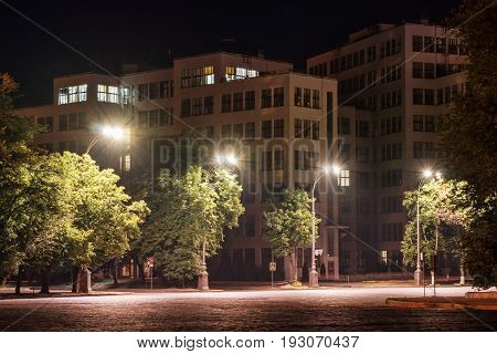 Beautiful city building in the light of street lamps. Night scene
