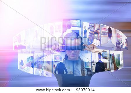 Young woman experiencing virtual reality simulator against modern stairs in office building