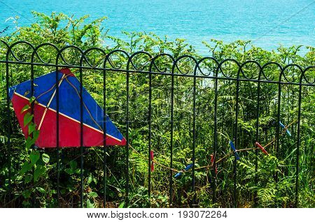 Metal Ornament On A Balustrade In A Seaside Village, A Symbolic Element In The Shape Of A Kite
