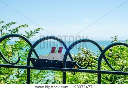 Metal Ornament On A Balustrade In A Seaside Town, Symbolic In The Shape Of Ship