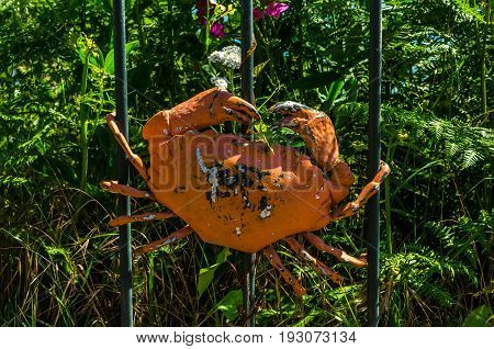 Metal Ornament On A Balustrade In A Seaside Village, Symbolic In The Shape Of A Crab