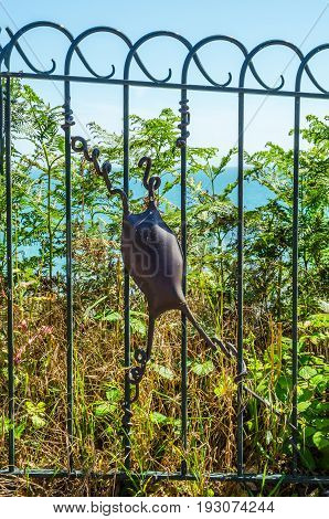 The Metal Ornament On A Balustrade In A Seaside Town, Symbolic In The Shape Of A Sea Animal