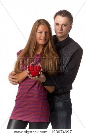 Young enamoured couple with a heart on a white background.