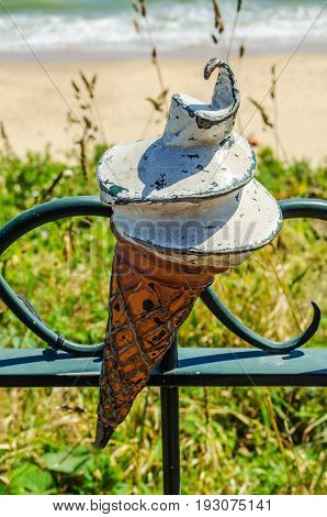 Metal Ornament On A Balustrade In A Seaside Village, A Symbolic Element In The Shape Of Ice Cream In