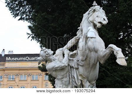 Vienna, Austria - April 3, 2014: Horse statue in front of the Natural History Museum in Hofburg complex, Vienna, Austria. The Maria Theresa square.
