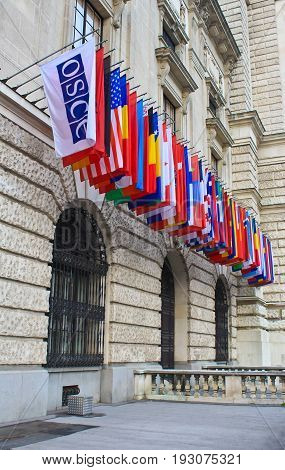 Vienna, Austria April 3, 2014:  International set of flags on Hofburg palace (OSCE headquarter), Vienna, Austria.