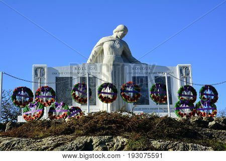 Victoria BC,Canada,November 11th 2014.A war memorial in Victoria BC,adorned with wreaths honoring lost soldiers on Remembrance Day.