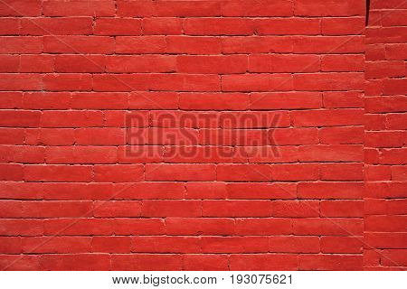 A sturdy red brick wall keeps people out and people in.