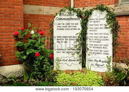Victoria BC,Canada,June 3rd 2015.The ten commandments on tablets in the church courtyard in Victoria BC.