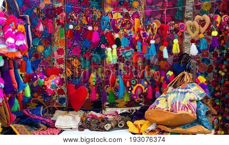 OAXACA MEXICO - MARCH 4: Colorful souvenirs for sale in a market in Oaxaca Mexico on March 4 2017