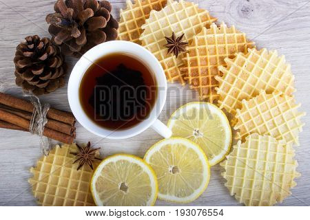 Cup Of Tea With Waffles And Cinnamon, Lemon, Badian, Pinecone