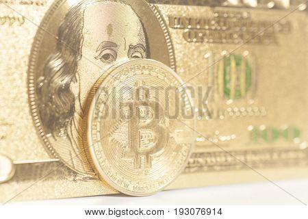 Golden bitcoin coins on us dollars .
