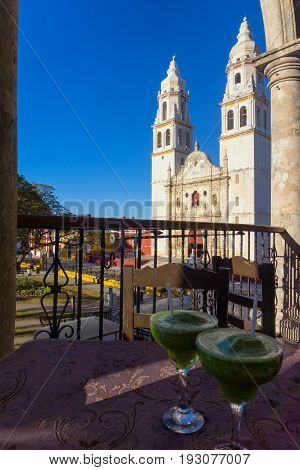 Cocktails with the cathedral in the background in Campeche Mexico