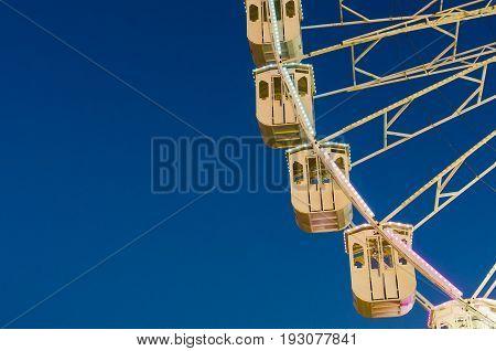 Ferris wheel on blue sky copy space