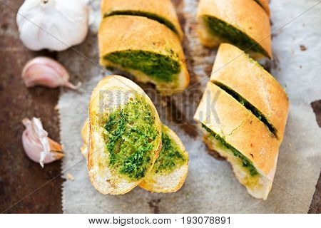 Garlic bread with parsley butter on baking sheet