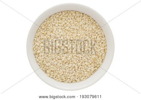 sesame seeds in white bowl, oilseed, from above, isolated on white background