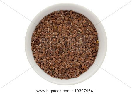 Unpeeled linseeds in white bowl, flax, from above, isolated on white background