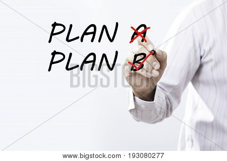 Man writing plan b on whiteboard after crossing out plan a - decision or alternative concept