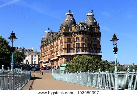 SCARBOROUGH, NORTH YORKSHIRE, ENGLAND - 19th of June 2017: Grand Hotel building viewed over the Spa bridge on 19th of June 2017 in Scarborough during a hot summer day