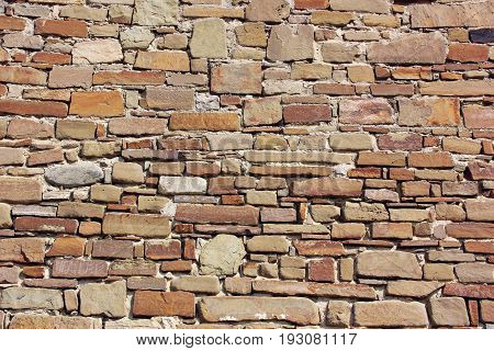Old wall made from stone masonry. Background backdrop. The texture of the stone.
