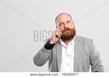 Pensive man with mustache, beard ,