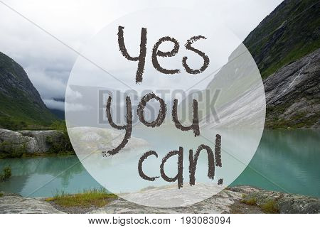 English Text Yes You Can. Lake With Mountains In Norway. Cloudy Sky. Peaceful Scenery, Landscape With Rocks And Grass. Greeting Card