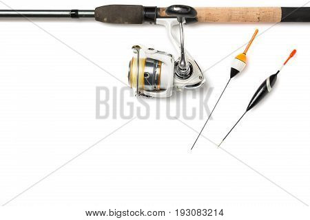 Fishing rod with reel and fishing buoys isolated on white background with free space.