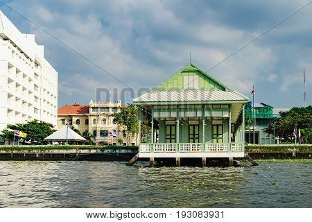 Old Chao Phraya River Thai traditional house, village riverfront in Bangkok, Thailand.