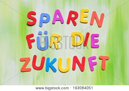 Colorful Letters, German Text, Concept Spare Money For The Future