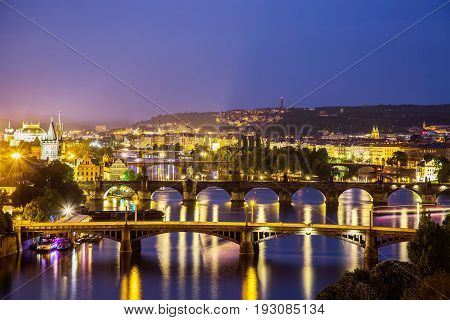 Prague at twilight blue hor, view of Bridges on Vltava