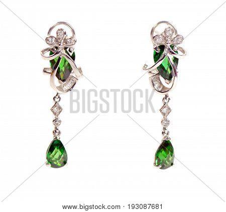Elegant beautiful emerald earrings on a white background
