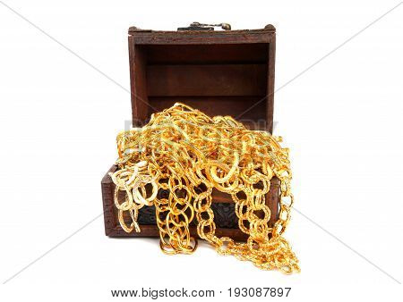 Accessory and gold jewelry in wooden jewel chest, over white
