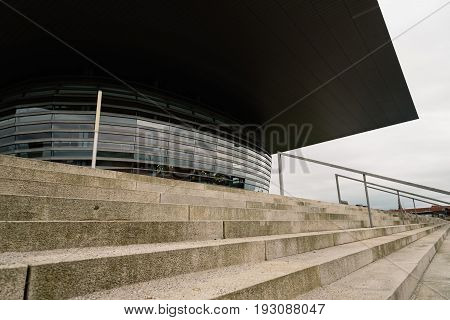 Copenhagen Denmark - August 12 2016: Exterior view of the entrance to Copenhagen Opera House and steps. It is the national opera house of Denmark and among the most modern opera houses in the world.