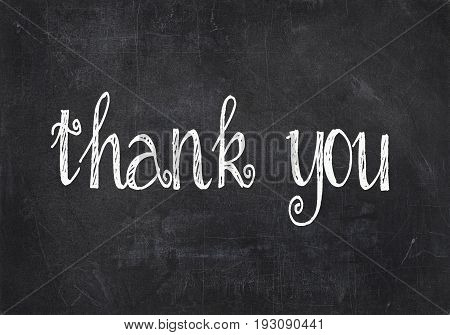 thank you text in chalk effect on textured black chalkboard