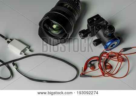 Wide-angle lens with earphone charger and ashtray with white background