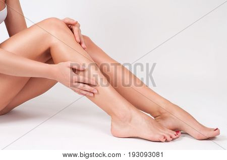 Hair Removal And Epilation. Woman Legs With Smooth Skin After Depilation.